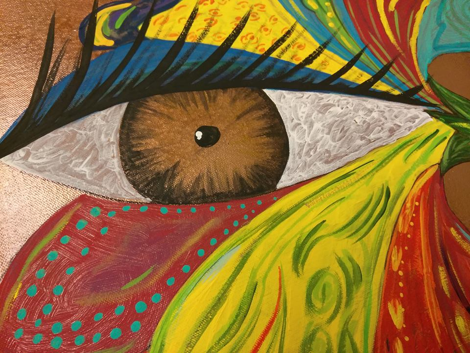 acrylic painting of a human eye surrounded by bright colors and patterns